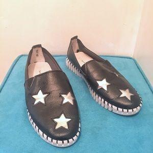 Black pleather slip on shoes with metallic stars
